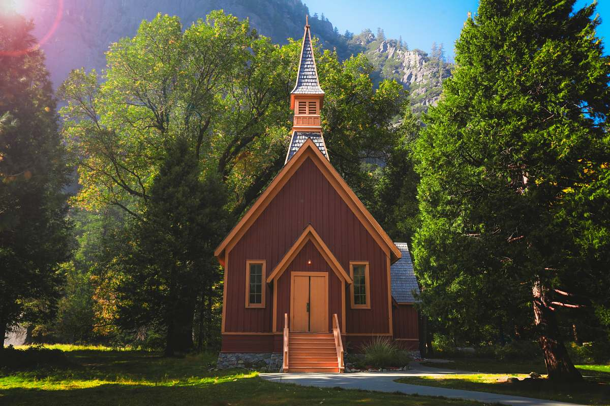 stock photos free  of architecture brown chapel surrounded with trees spire