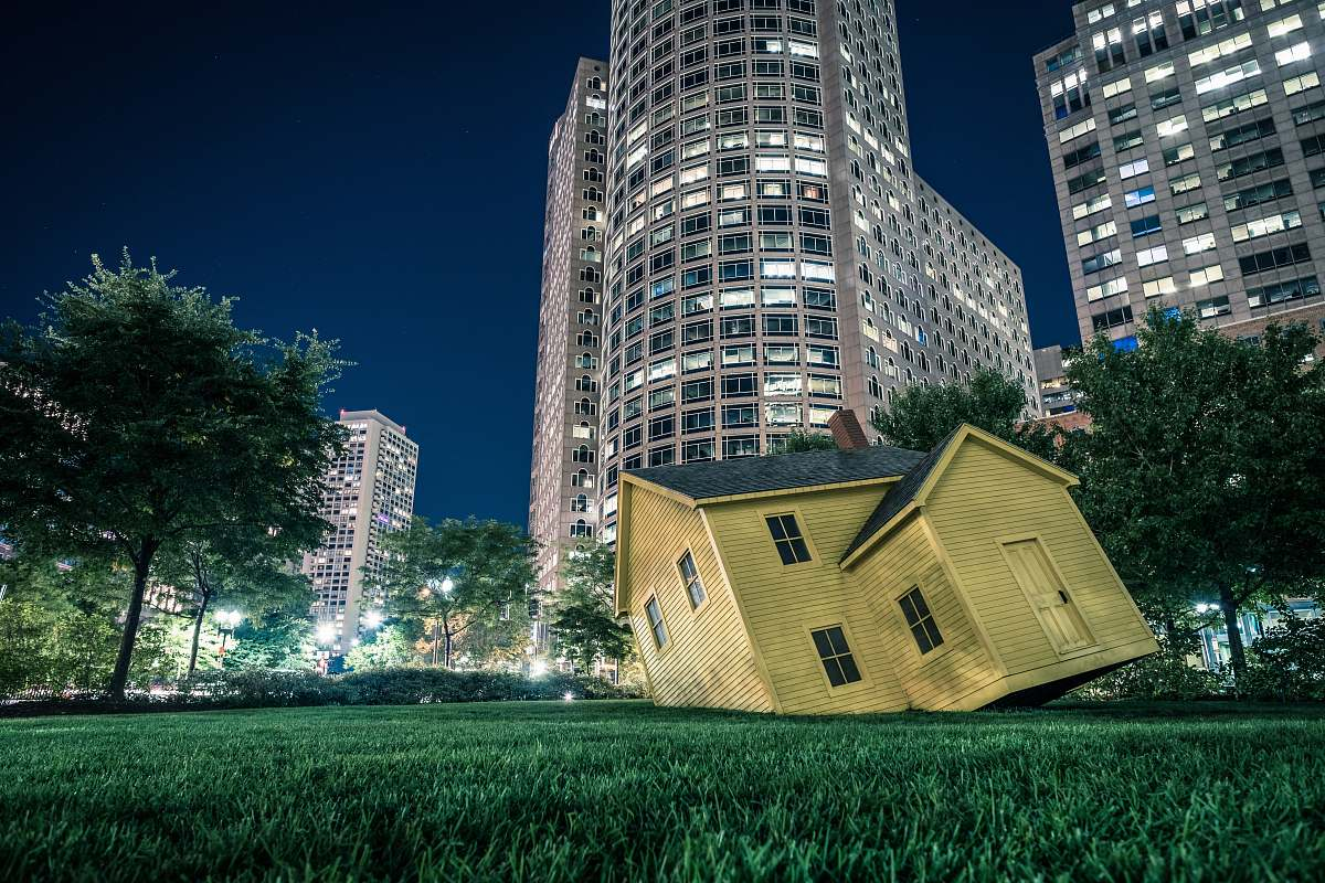 stock photos free  of housing yellow house on green grass overlooking buildings at nighttime boston