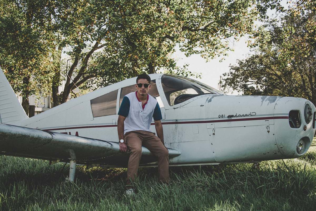 stock photos free  of people man sitting on biplane wing person