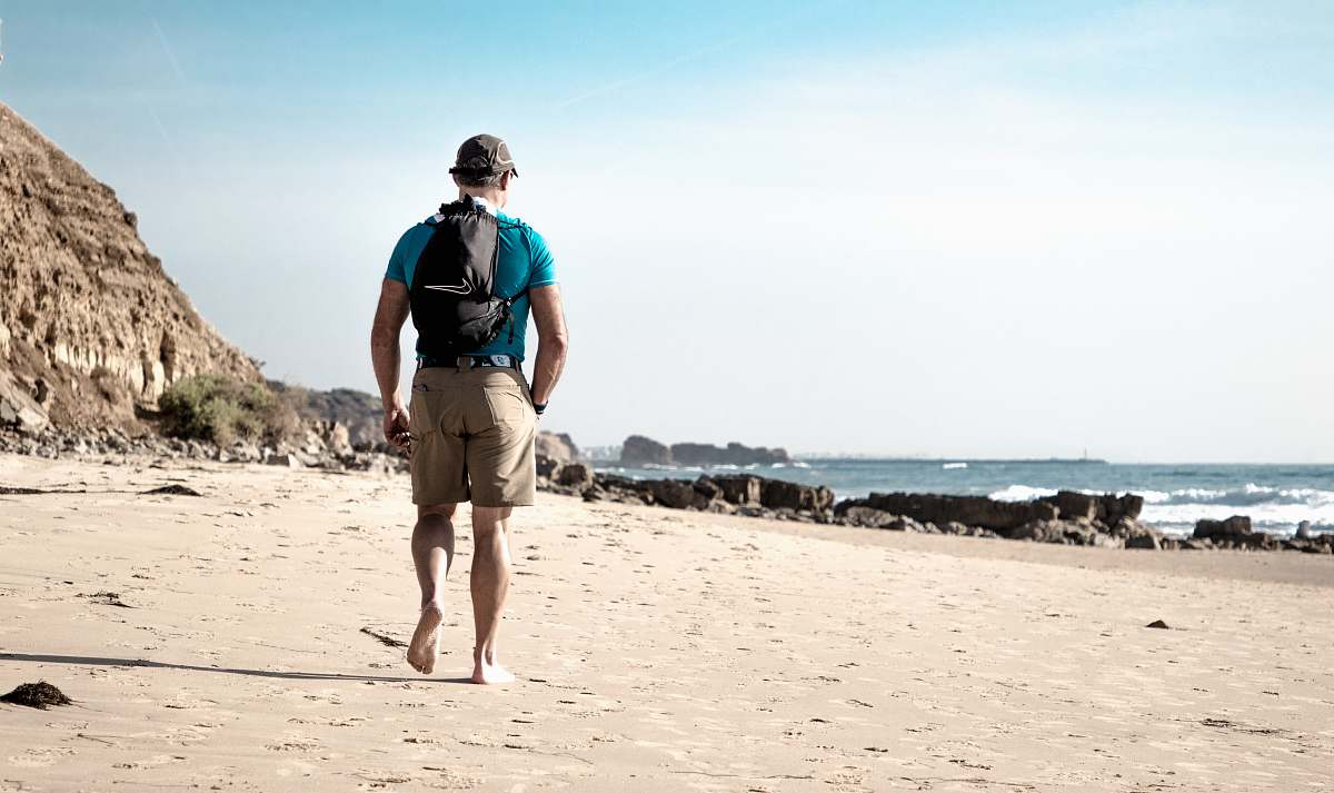 stock photos free  of people man waling in front of beach person