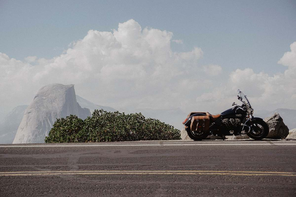 stock photos free  of transportation black cruiser motorcyle beside a black road vehicle