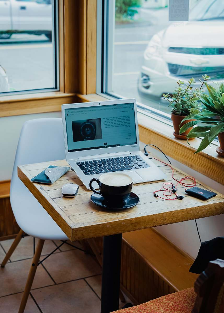 stock photos free  of laptop cup of coffee, laptop computer, and red earphones plugged in laptop on brown wooden table desk