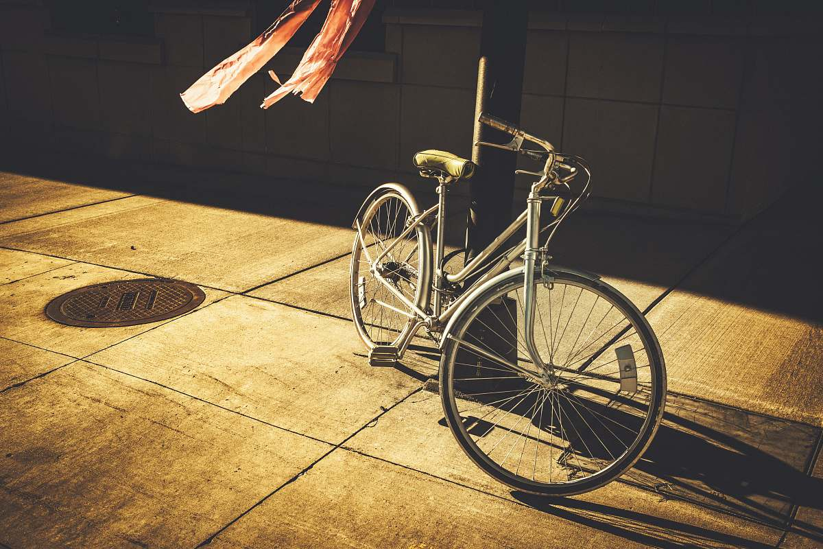 stock photos free  of bicycle gray step-through bike leaning on black post bike