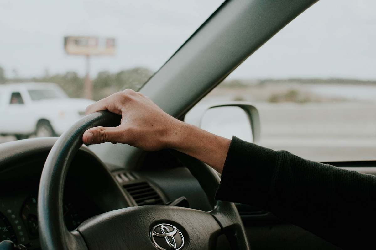stock photos free  of driving person driving Toyota car transportation