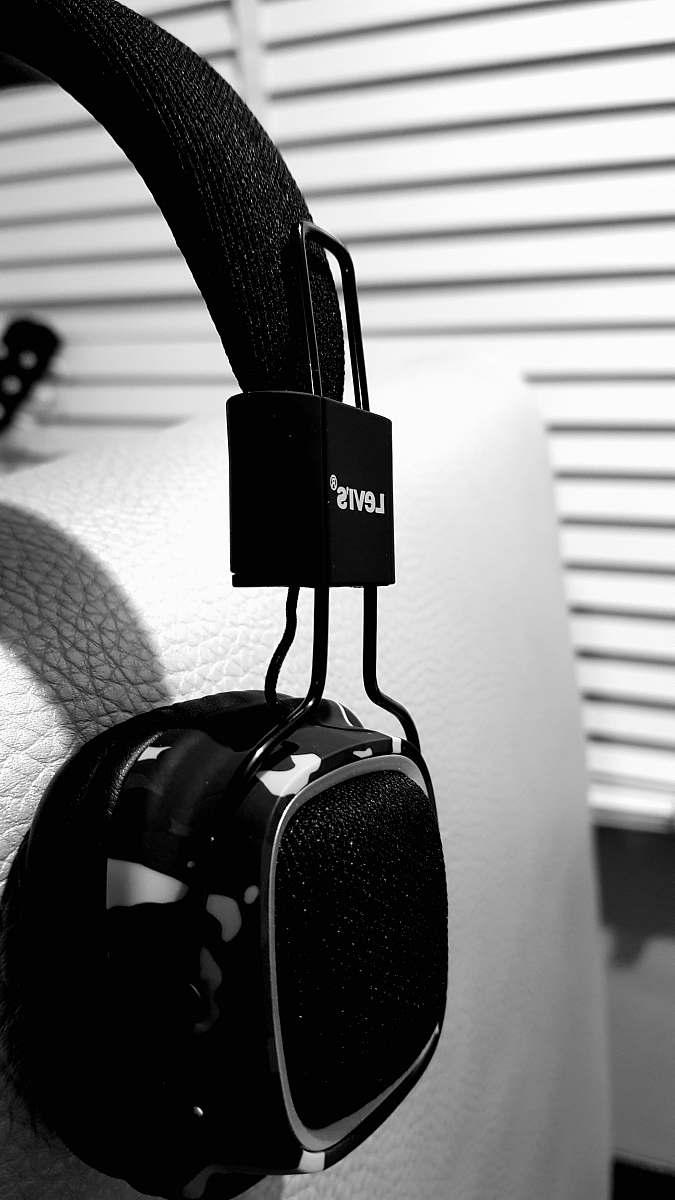 stock photos free  of electronics black headphones on gray sofa headphones