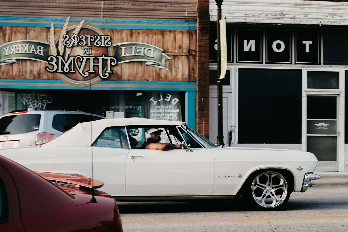 stock photos free  of transportation person riding on a white coupe vehicle