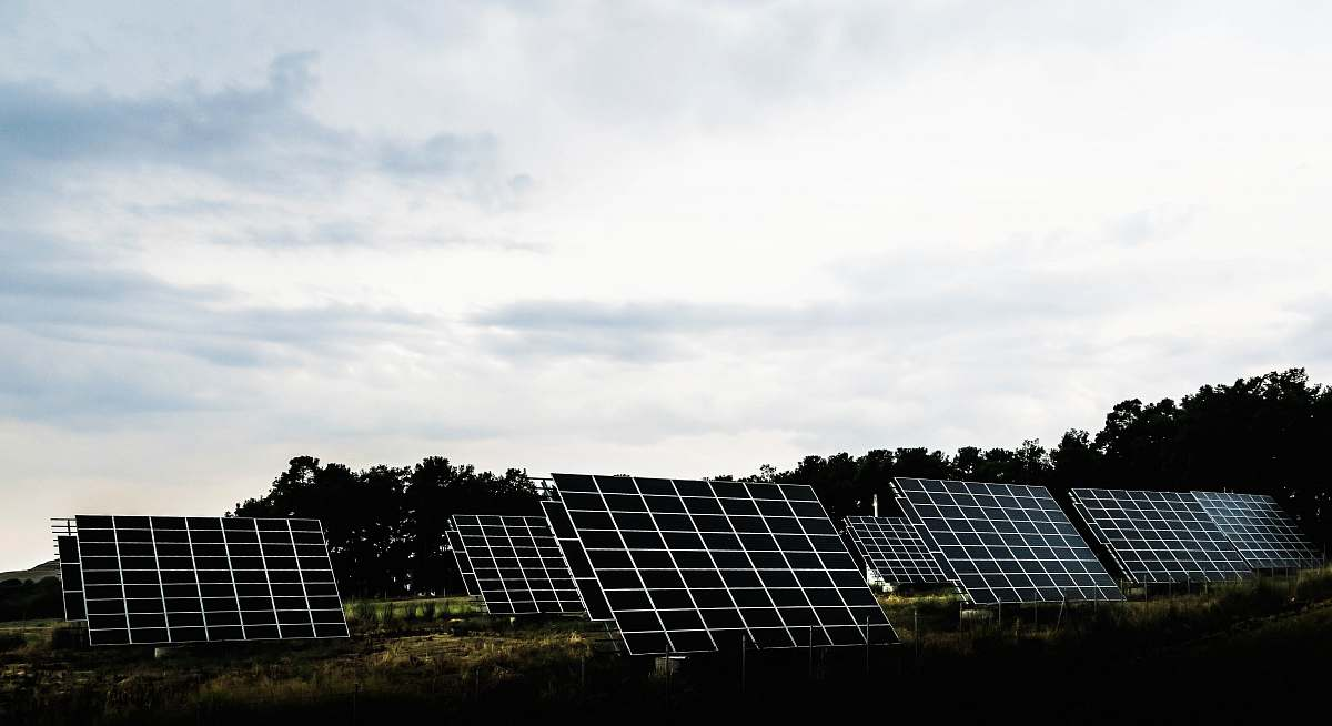 stock photos free  of greece silhouette photography of assorted solar panel behind trees solar