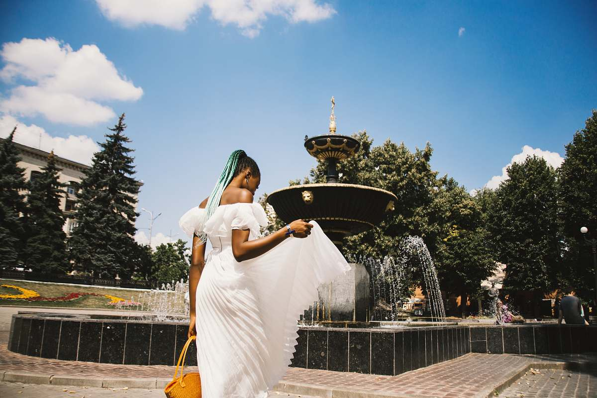 stock photos free  of people woman standing near water fountain person