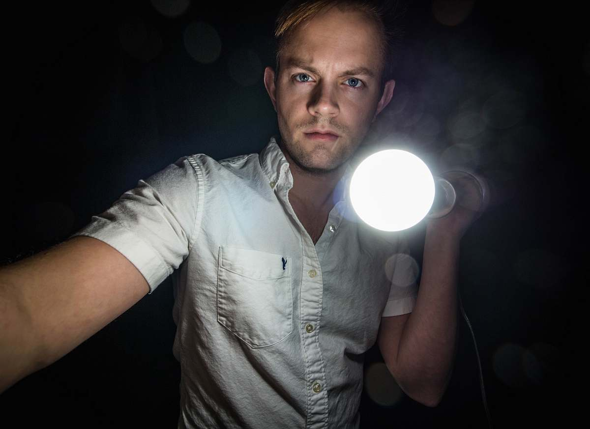 stock photos free  of human man holding bulb people