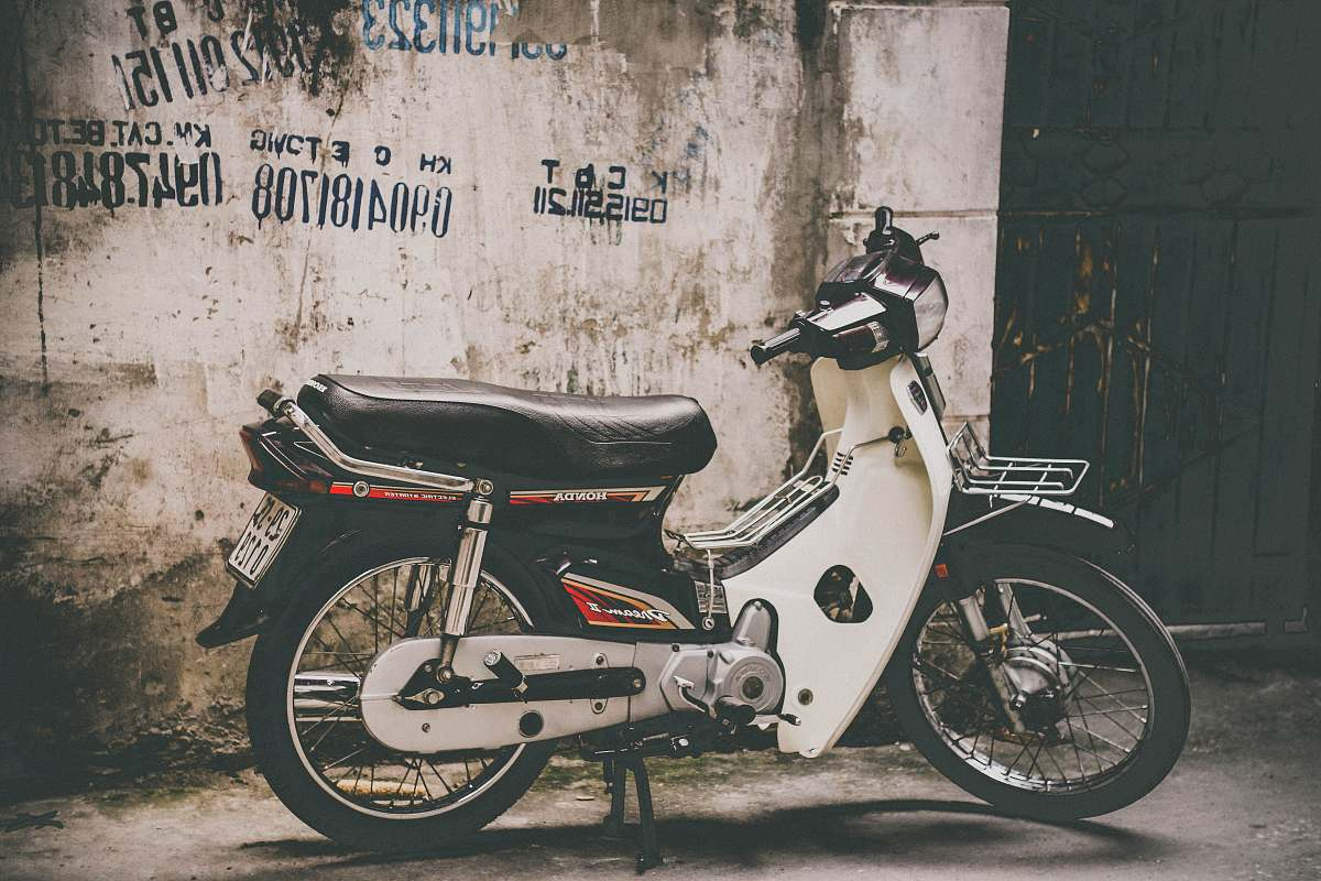 stock photos free  of motorcycle white and black underbone motorcycle parked near the wall vehicle