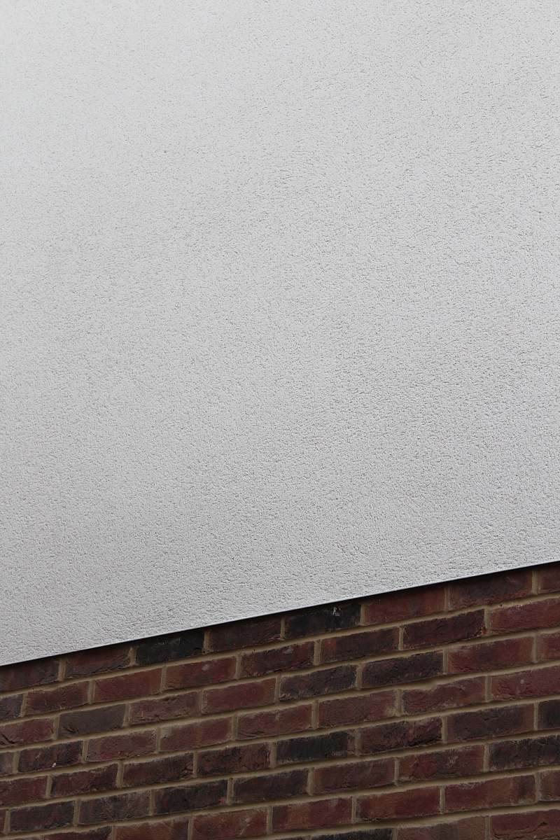 stock photos free  of rug red brick wall and plain white concrete wall wall