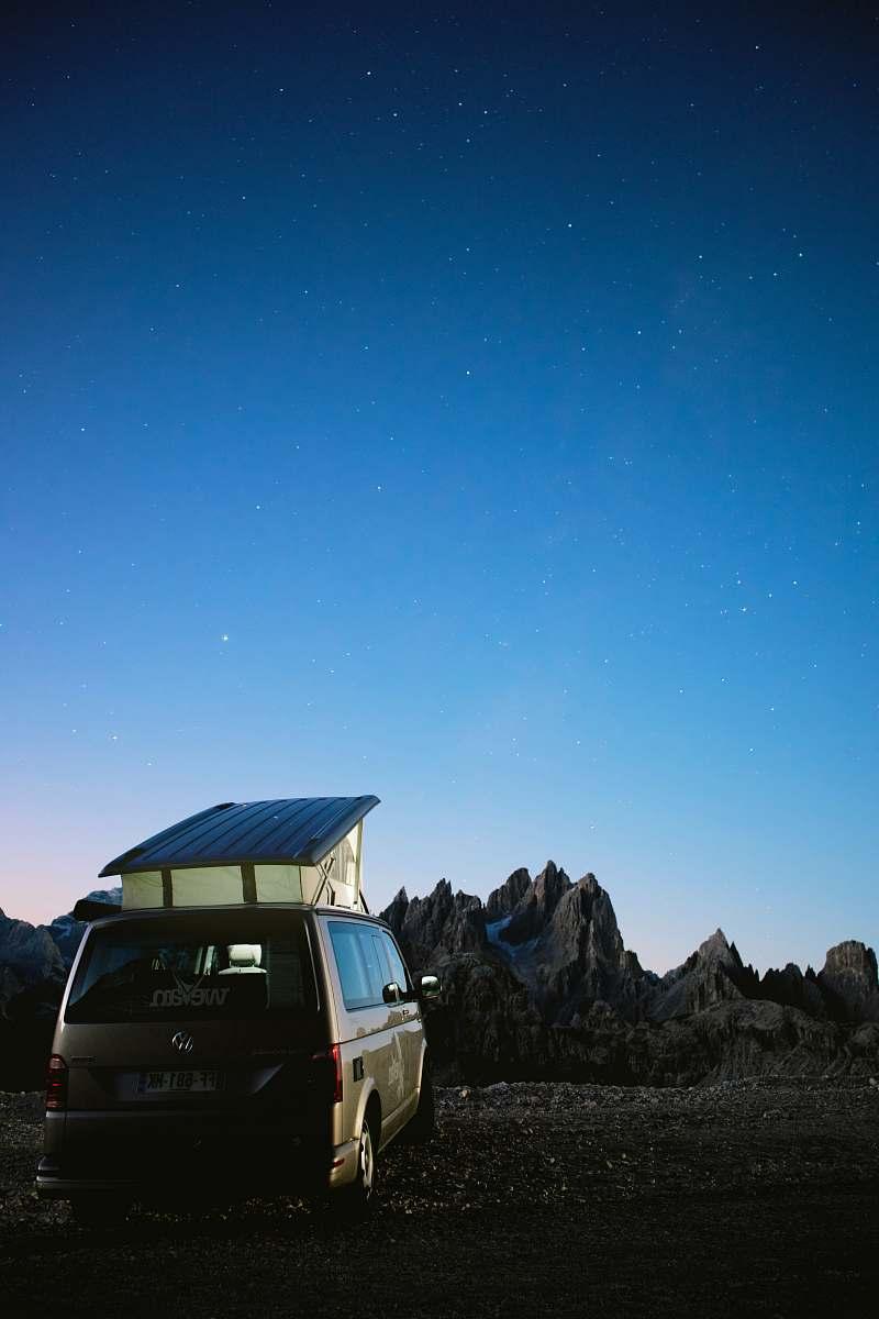 stock photos free  of transportation brown camper van parked outside during clear blue sky vehicle