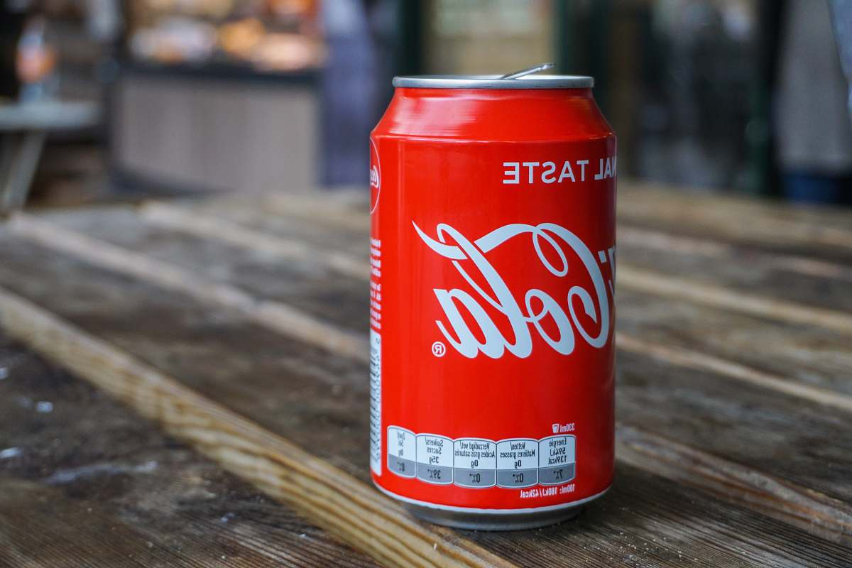 stock photos free  of tin Coca-Cola can on brown wooden table drink