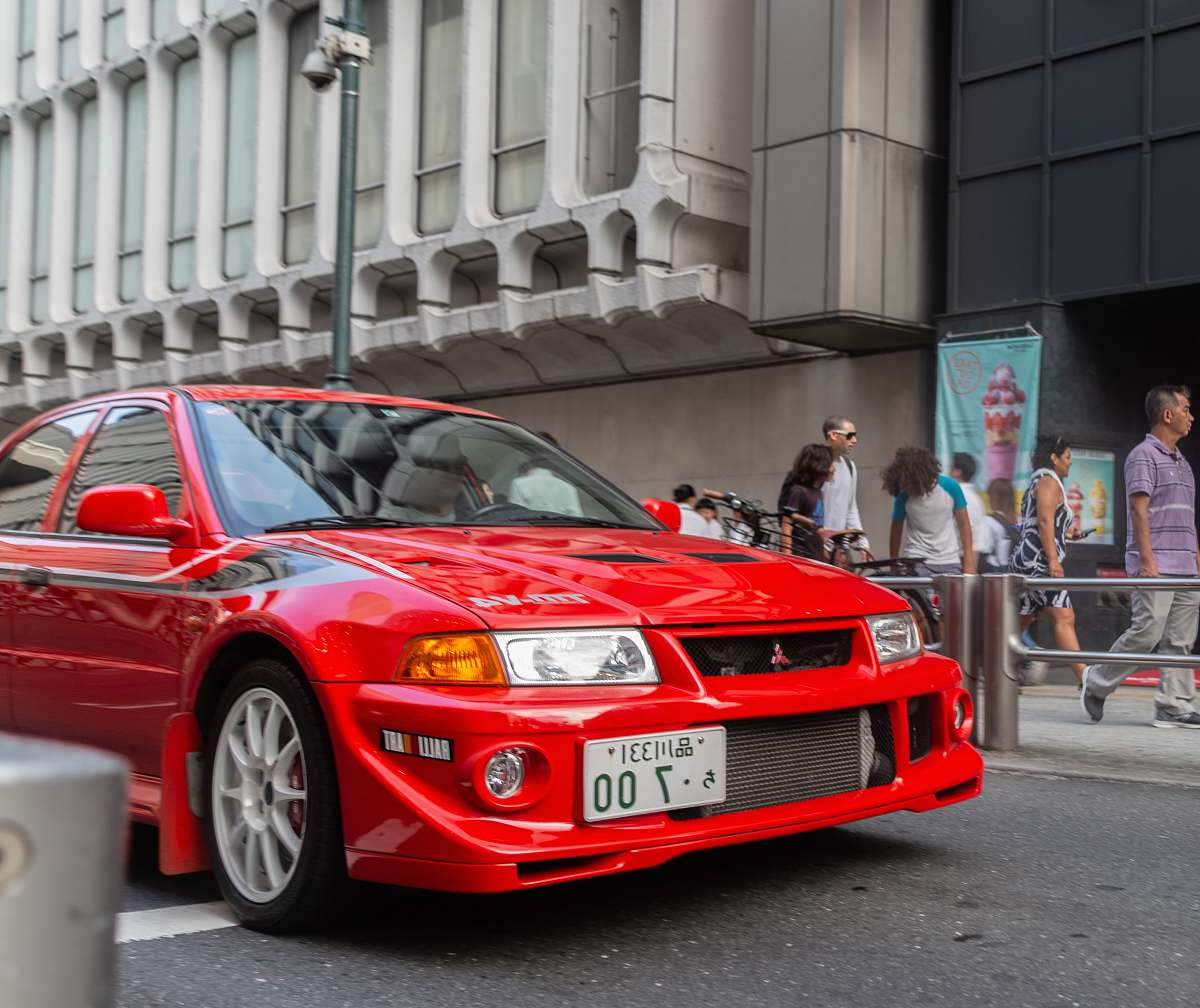 stock photos free  of automobile red Mitsubishi vehicle on road transportation