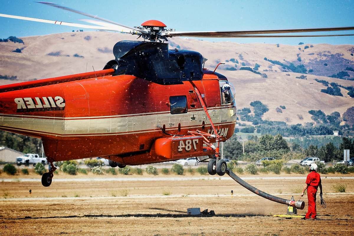 stock photos free  of transportation red and white Siller chopper ascending aircraft