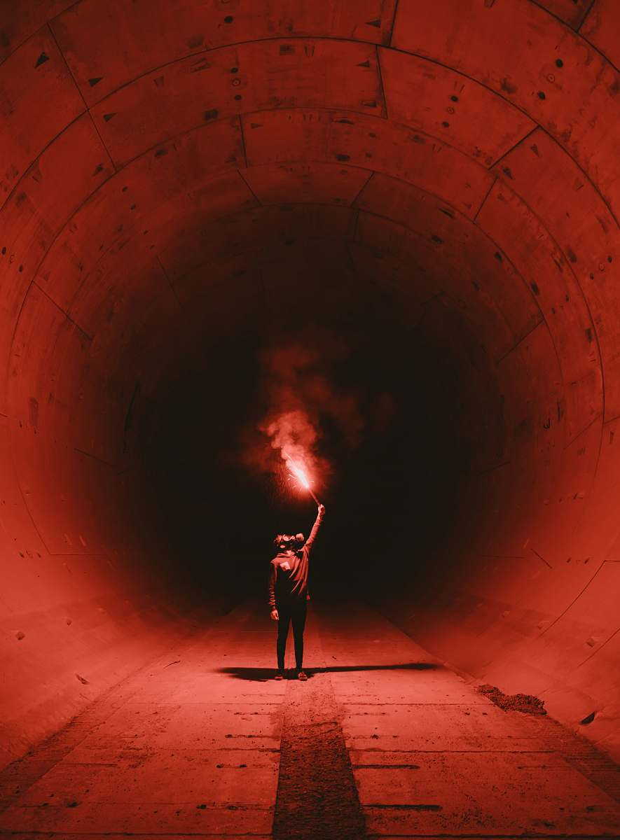 stock photos free  of person man wearing gas mask holding torch inside tunnel tunnel