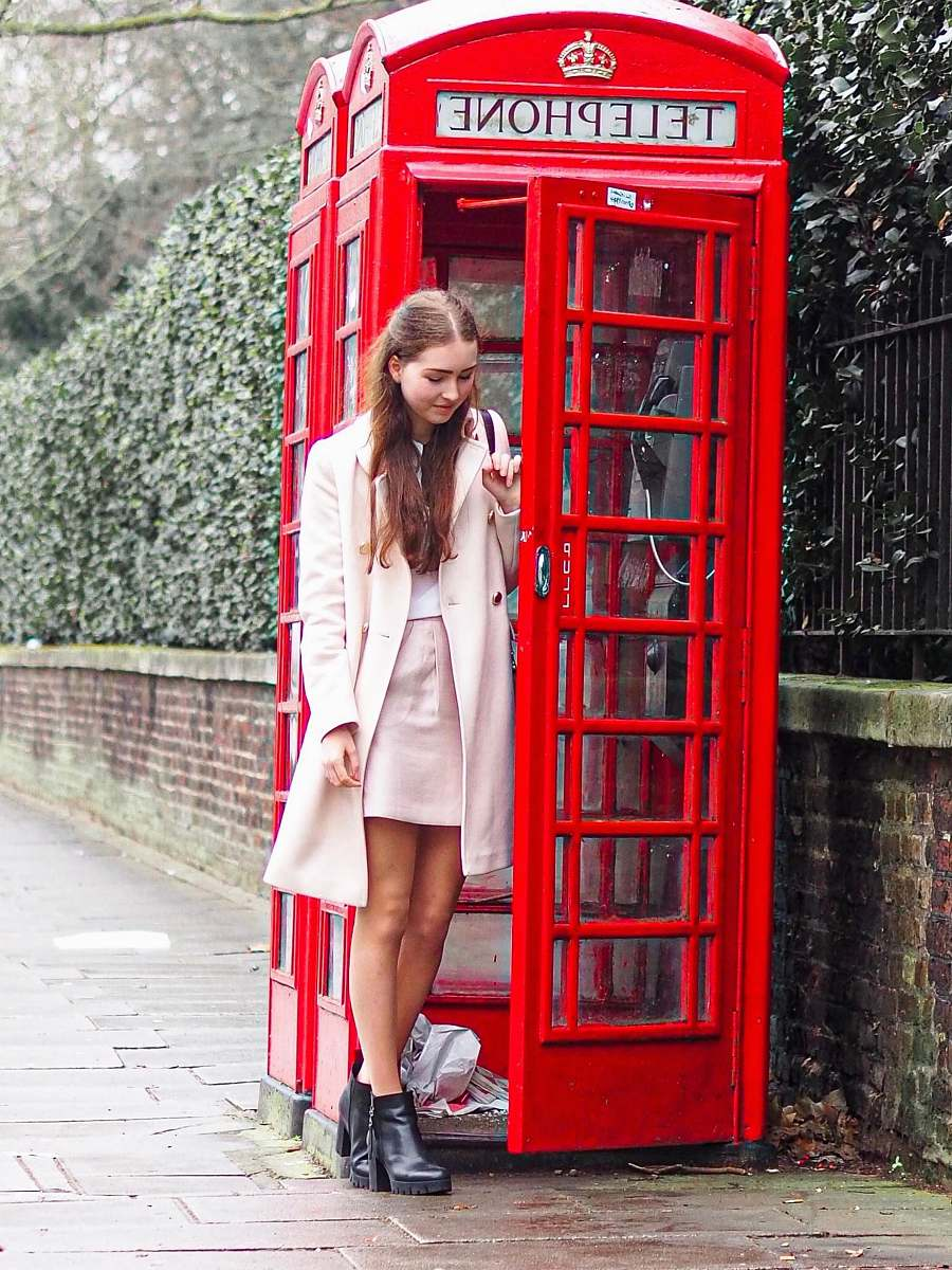 stock photos free  of person woman standing near the red telephone booth london
