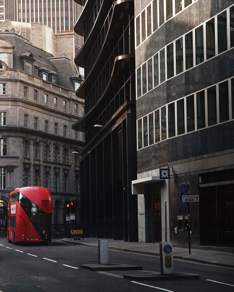 stock photos free  of bus red bus in front of black painted building transportation