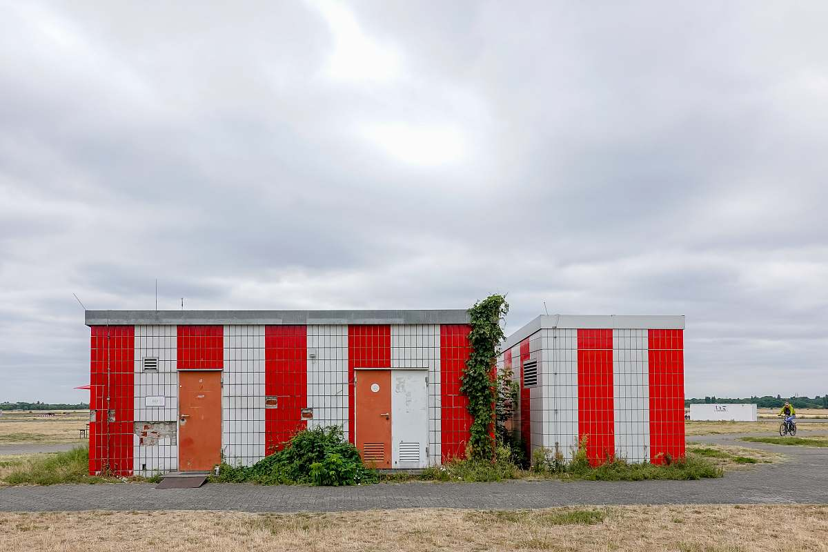 stock photos free  of vegetation white and red striped building during daytime bush