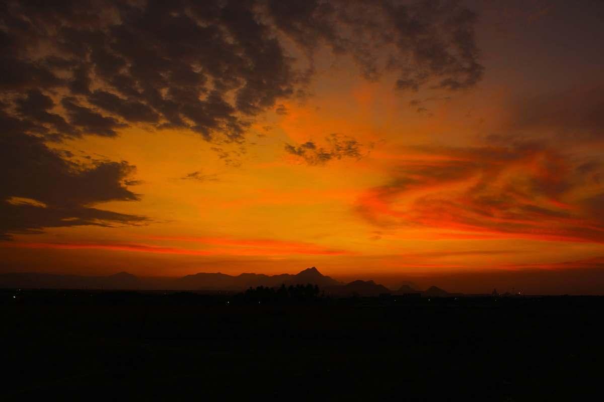 stock photos free  of sunrise mountains under orange kies sunset