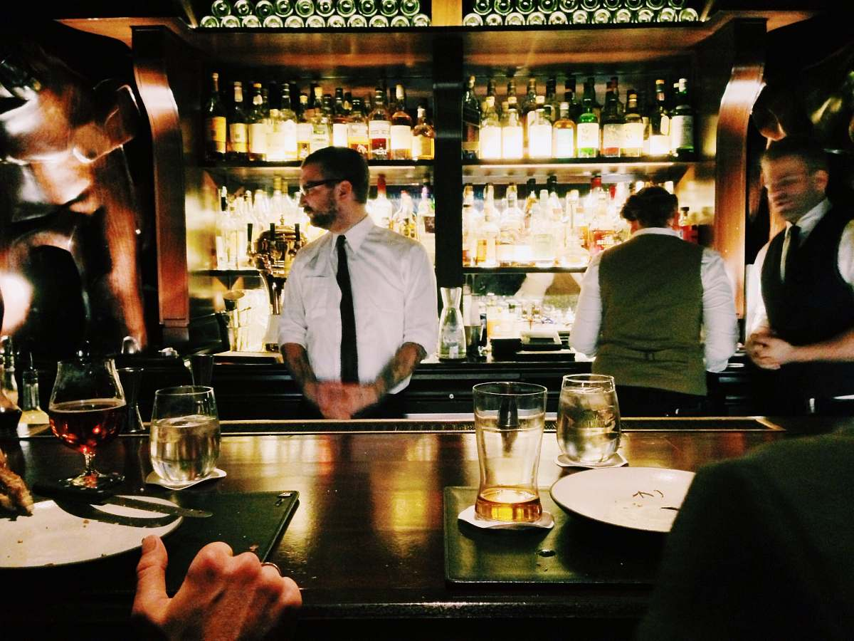 stock photos free  of human bartender standing beside table person