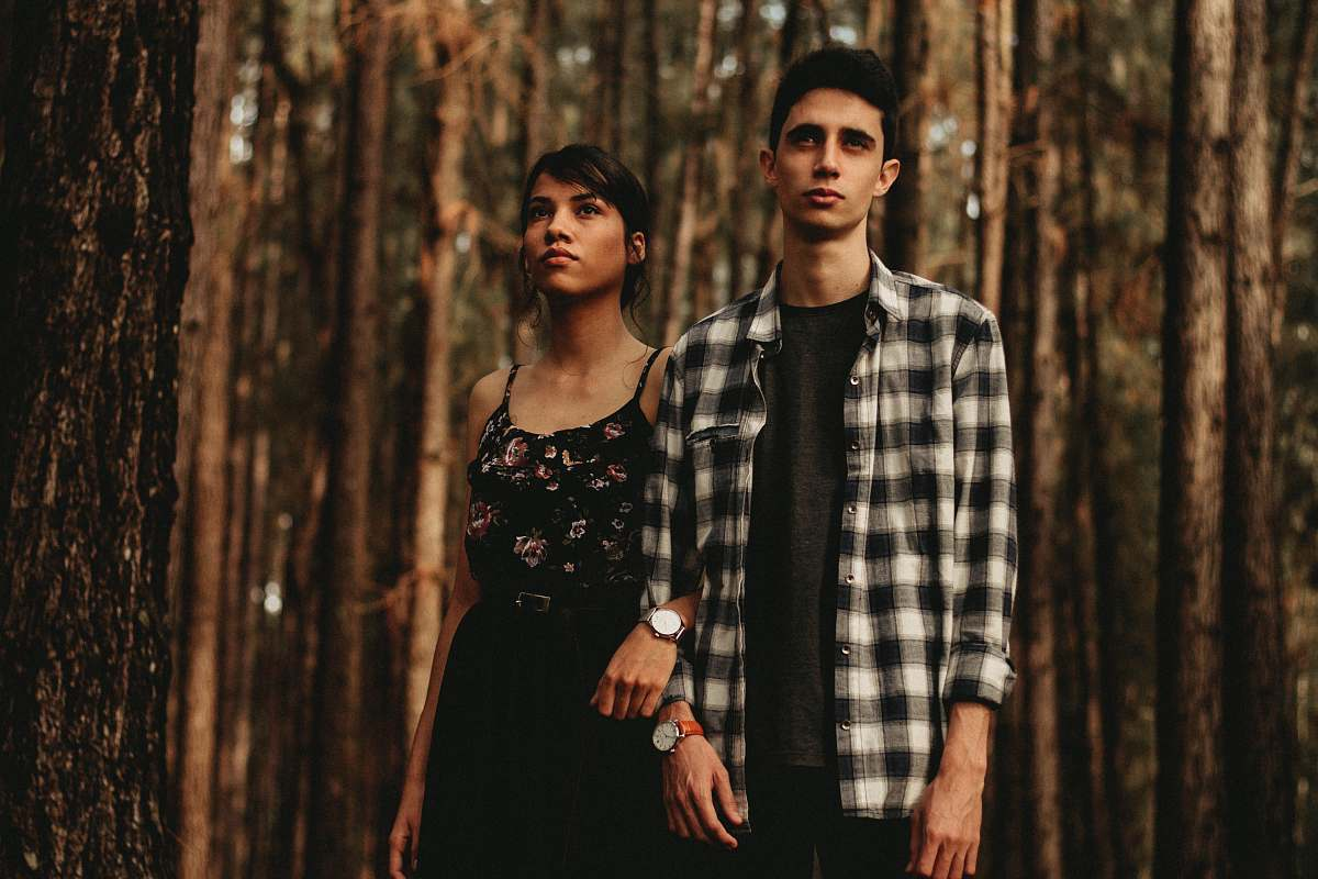 stock photos free  of human man and woman standing next to another in forest person