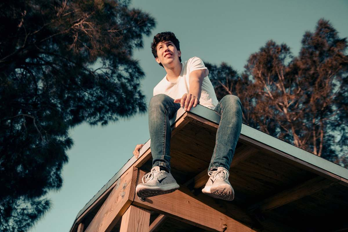stock photos free  of person man sitting on roof human