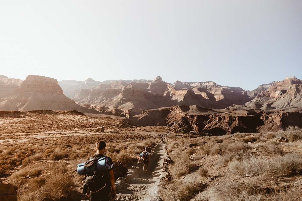 stock photos free  of person man walking on empty place surrounded by brown rock formation nature