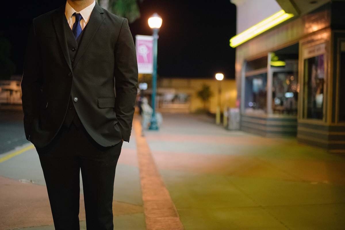 stock photos free  of person man walking on standing putting is hands inside pocket suit