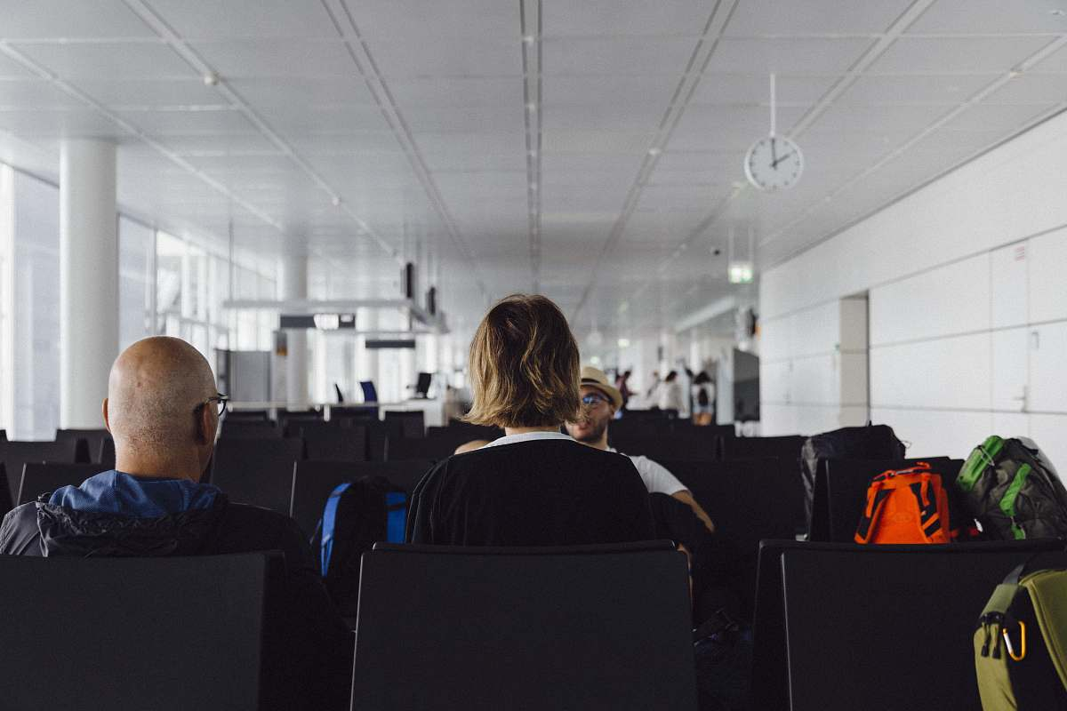 stock photos free  of human people sitting on airport luggage
