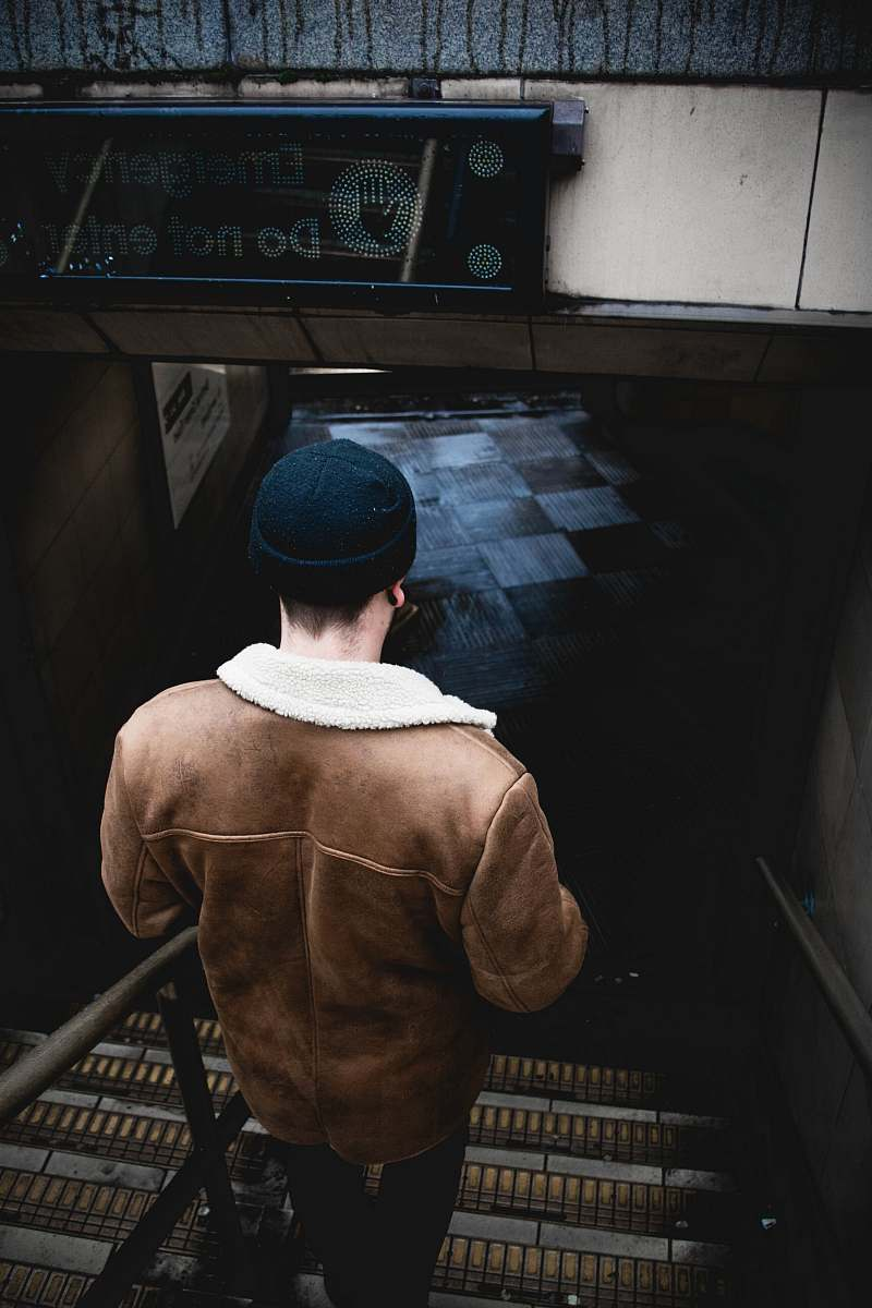 stock photos free  of person person in brown jacket walking on the stair human