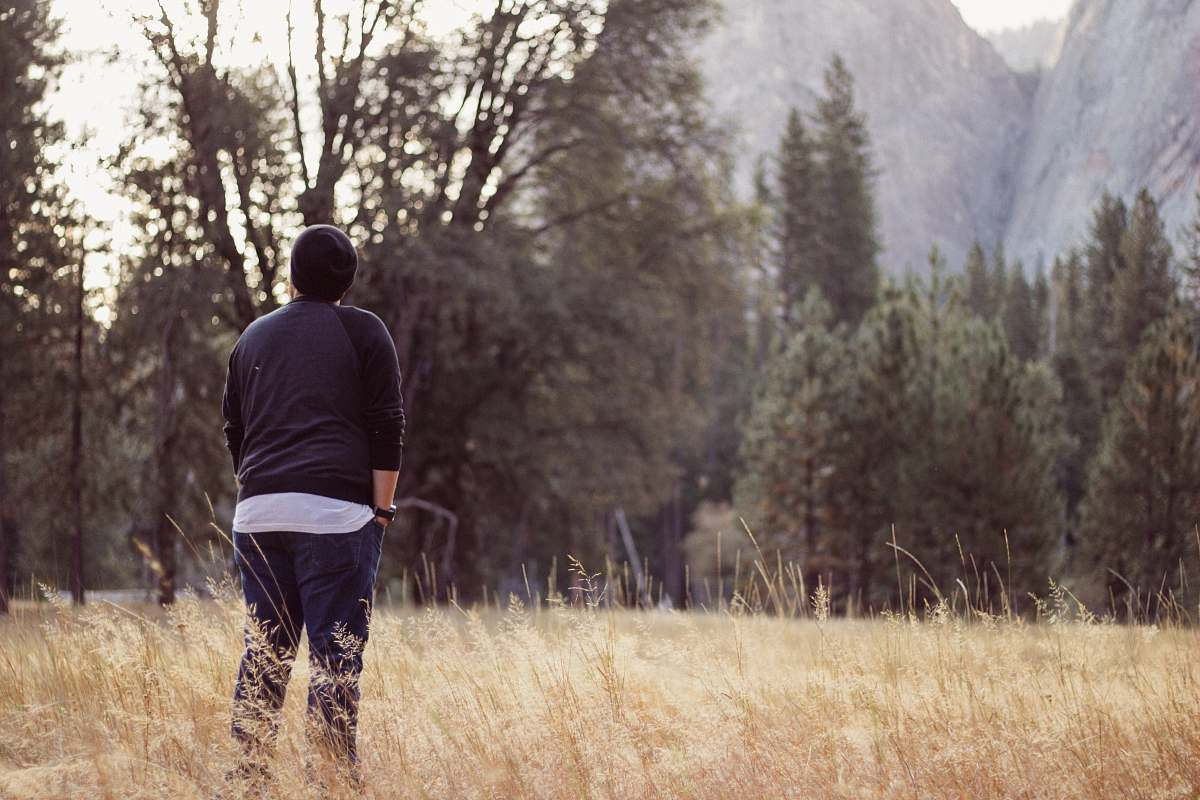 stock photos free  of person person wearing black beanie and raglan shirt while being photograph during day time human