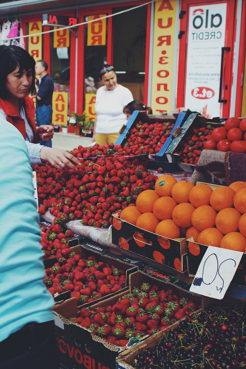 stock photos free  of fruit woman buying strawberries at the market food