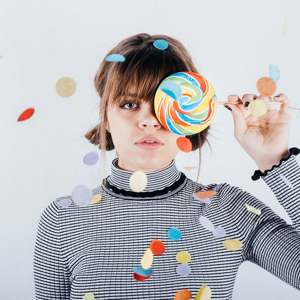 stock photos free  of person woman covering her right eye with lollipop human