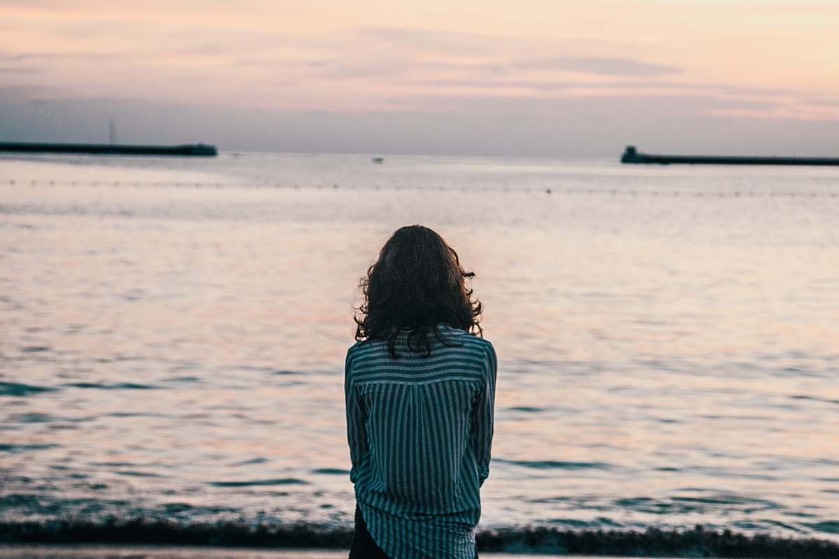 stock photos free  of human woman in front ocean water under white sky back