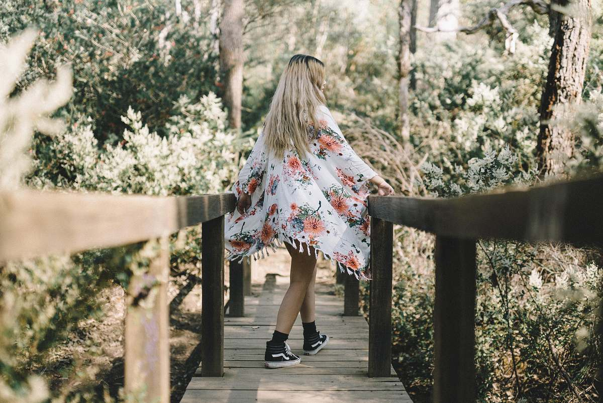 stock photos free  of person woman walking along wooden foot bridge leading to forest human