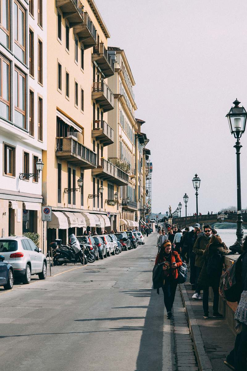 stock photos free  of people group of people walking near buildings and body of water during daytime human