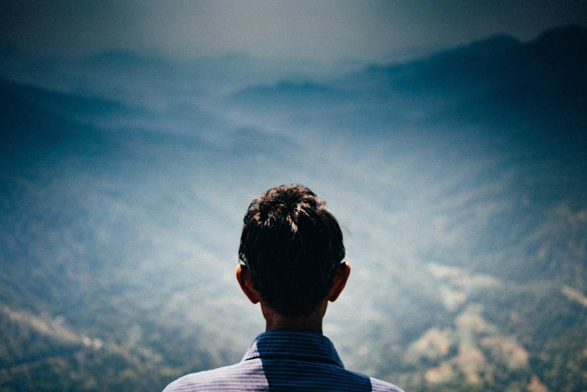 stock photos free  of people man facing green mountains during daytime human