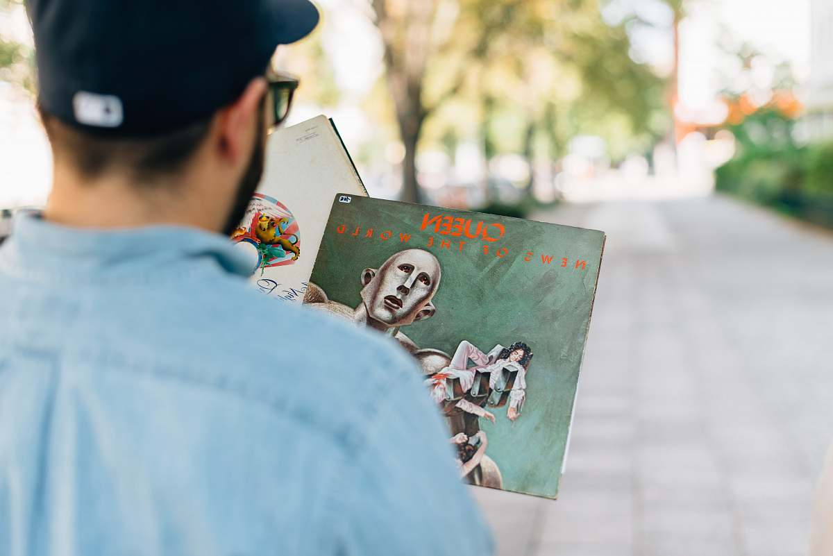 stock photos free  of people man holding vinyl album in shallow focus photography human