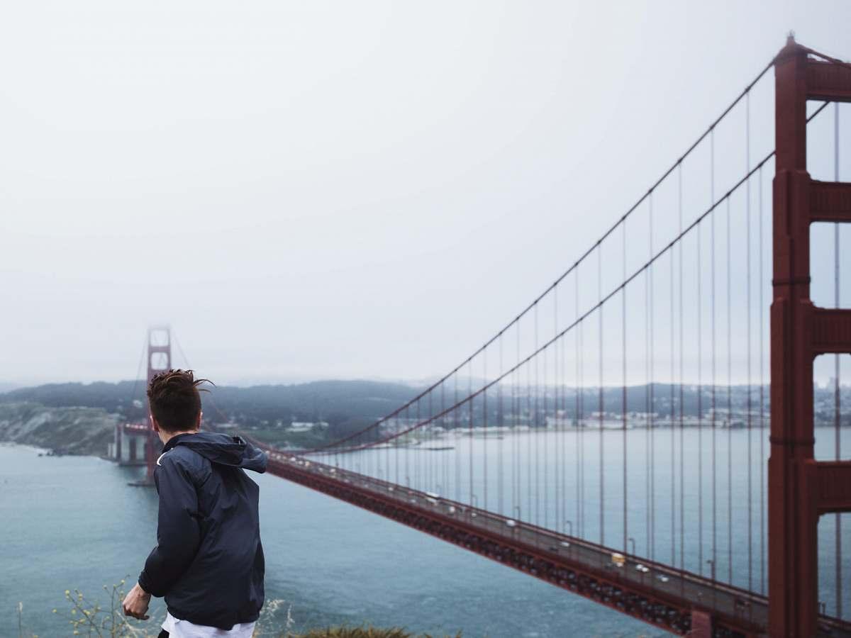 stock photos free  of people man standing near Golden Gate Bridge san francisco