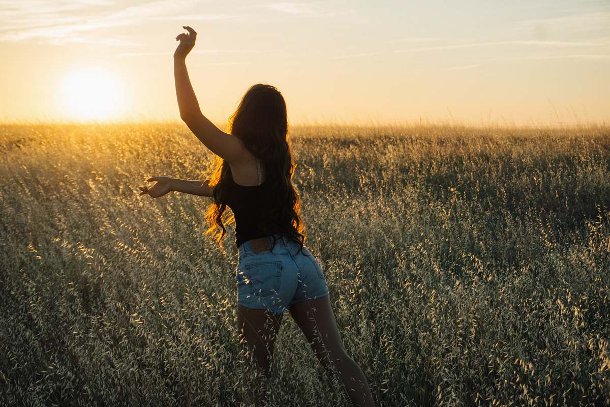 stock photos free  of people woman dancing at green grass field during sunset human