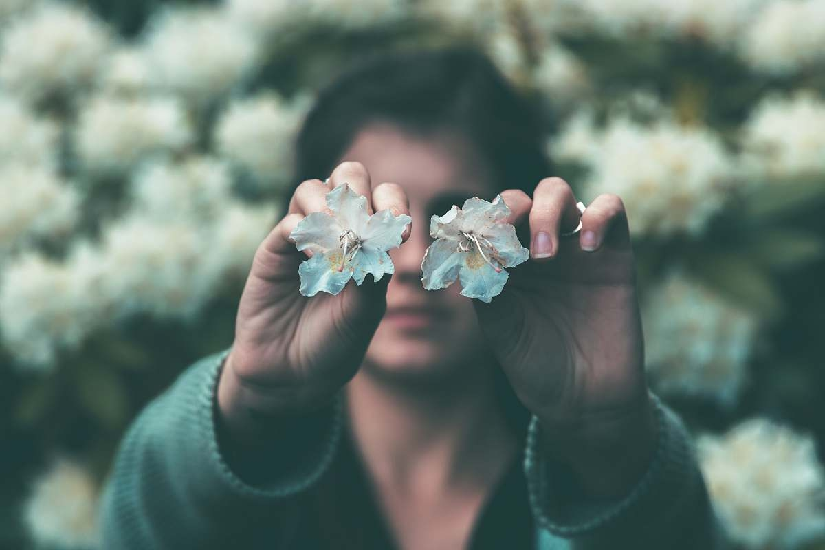 stock photos free  of people woman holding two teal flowers in bloom human
