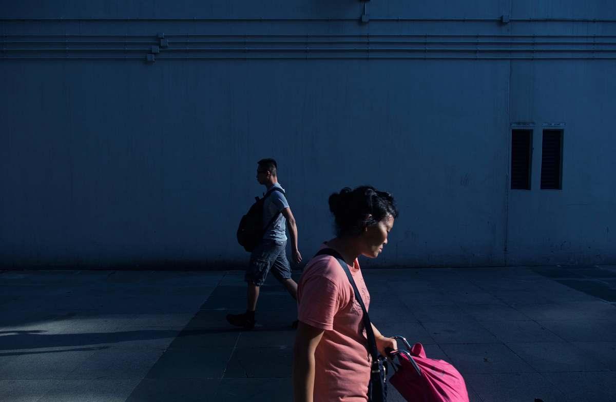stock photos free  of human woman walking near man beside white wall at daytime people