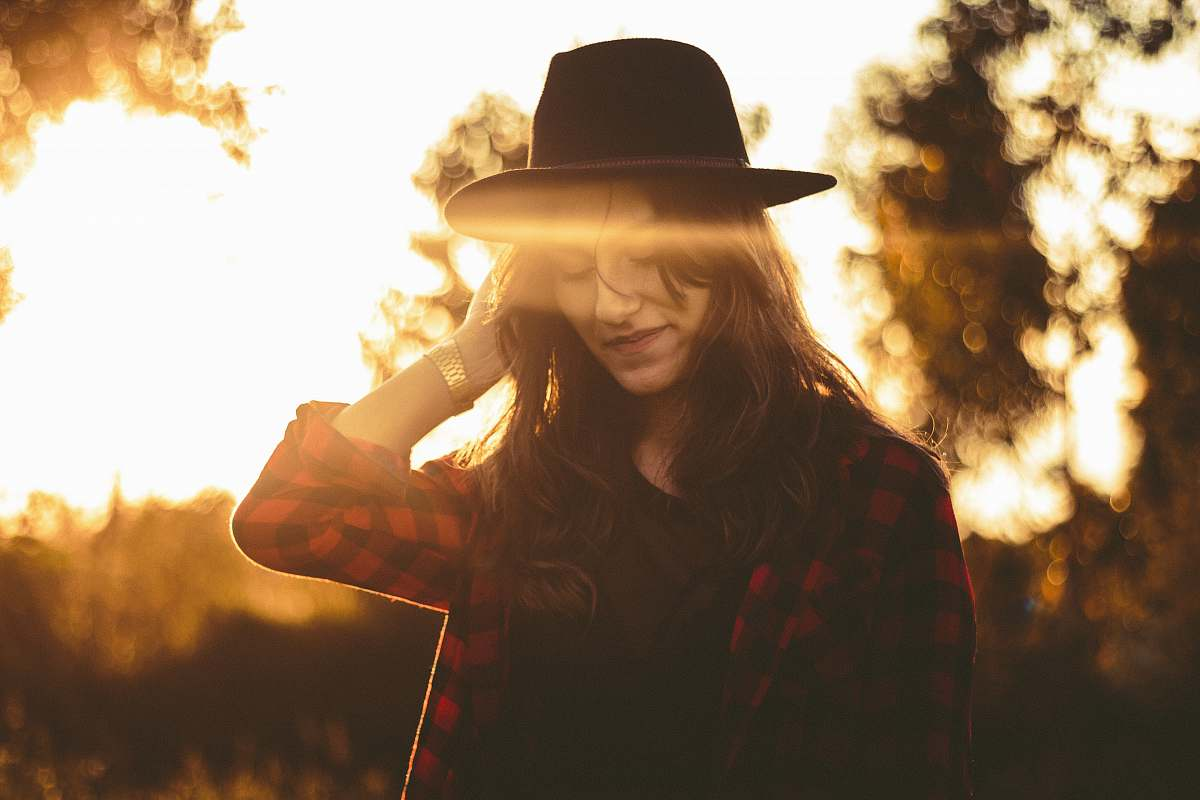 stock photos free  of woman woman wearing red and black checked top and black hat hat