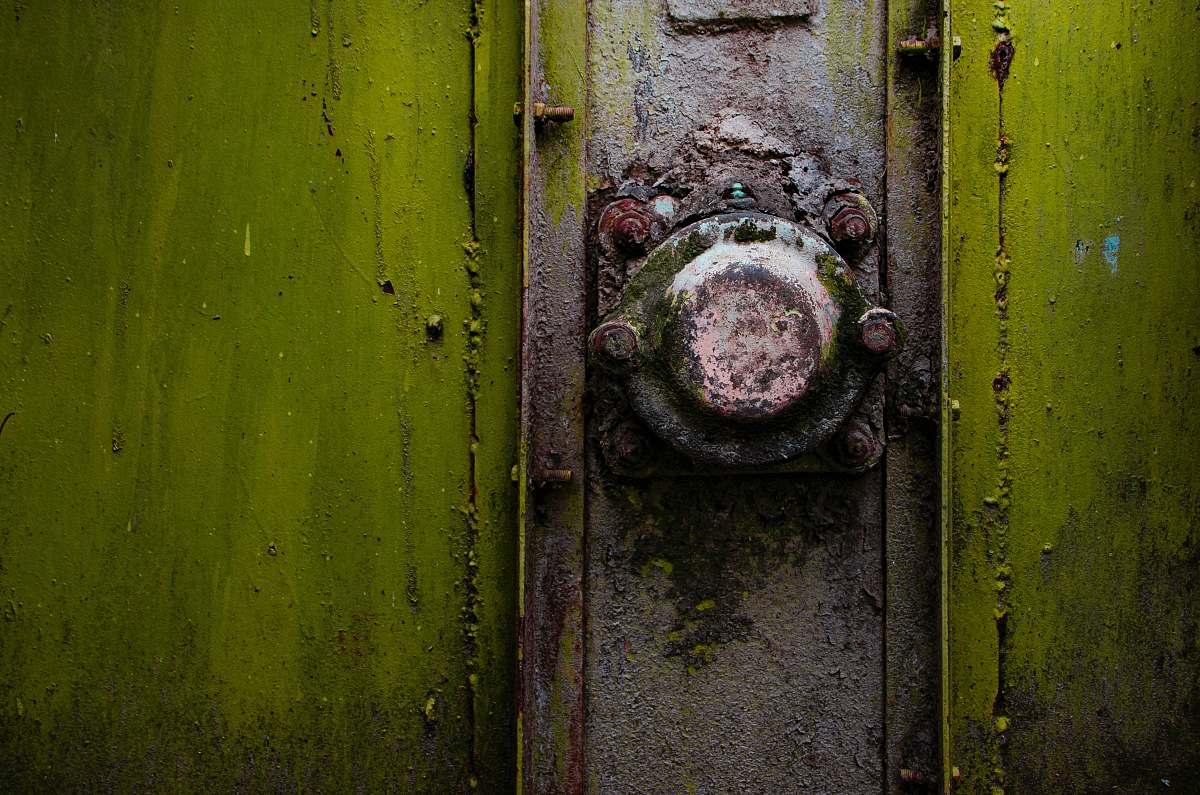 stock photos free  of rust A close-up of a rusty metal knob on a green strongbox romania