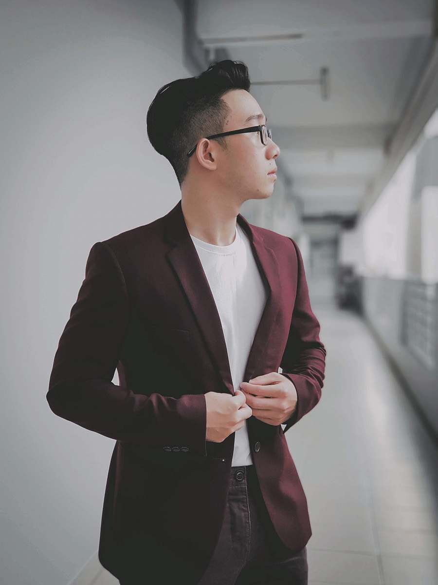 stock photos free  of apparel man buttoning his maroon formal suit jacket suit
