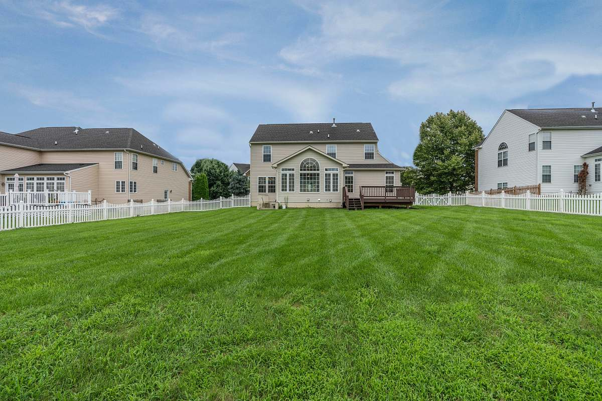stock photos free  of plant three 2-storey houses with fences and grass field lawn