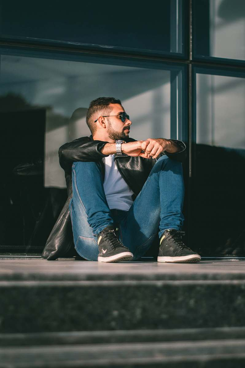 stock photos free  of person man sitting on floor leaning on glass wall inside room people