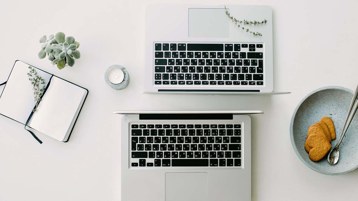 Desk Two Silver Laptop Computers Besides Clear Glass Jar Office Image Free Stock Photo