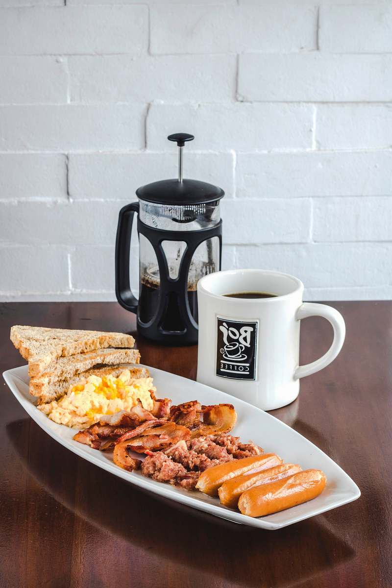 stock photos free  of meal bread and bacon platter beside French press breakfast